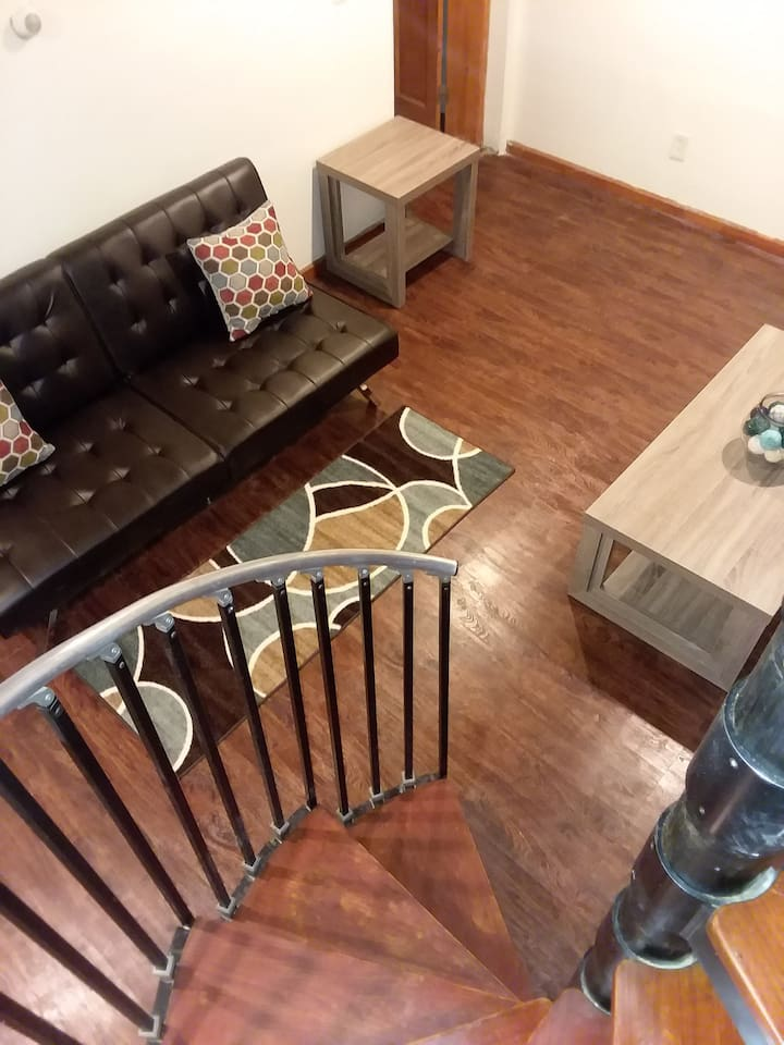 Duplex Unit Spiral Stairs, as well as back stairs that allows access to both floors. 2 Bedroom,  2 Bathroom. 1 Bedroom/bathroom on each floor. Dining room, Kitchen with an open floor concept. Private backyard space. Jacuzzi tub in lower level bathroom. Laundry room. TV on both floors w/WiFi.