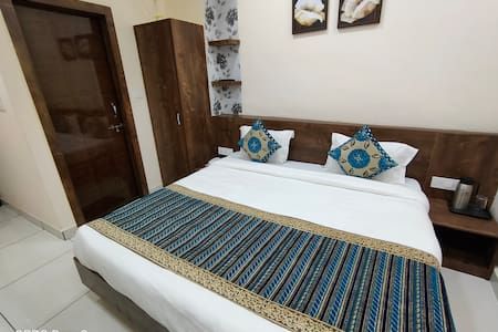 """AC Well Furnished Executive Room 135 Sqft with Super Silent Hitachi Split AC, King size beds, 7"""" Spring Mattress, WiFi, Bed side Charging points, EPABX, Power Backup, Cupboards, Power Savers, Writing Desk cum Luggage Rack, Geyser & Modern Toilets."""