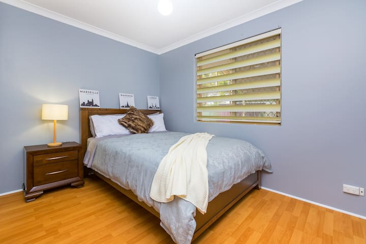 The third bedroom located at the rear of the property with queen bed & robe.