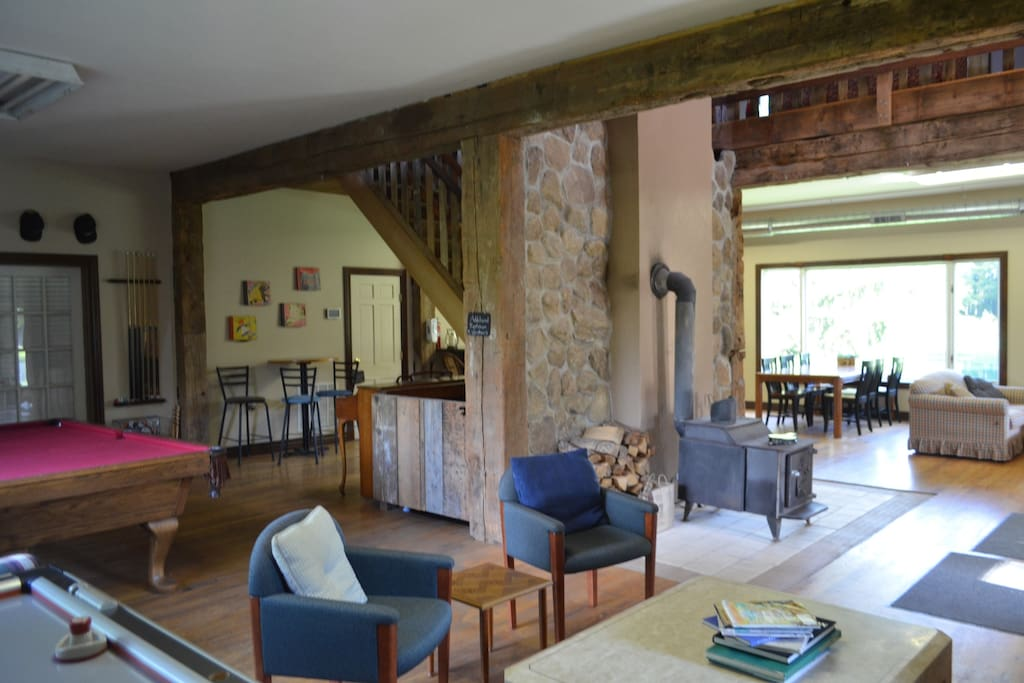 Main floor offers a nice flow, surrounded by original beams, and wood planks from the original barn from the property