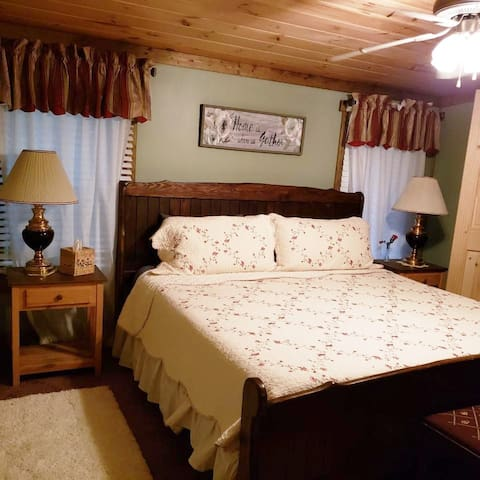 Comfortable, king size bed in master suite.