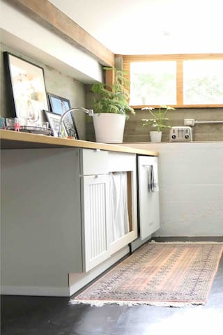 Our petite + efficient kitchen is complete with everything you need to make a small meal at home. A full size fridge is great for storing all the fresh fruits + veggies you find at one of the many farmer's markets or local farms.