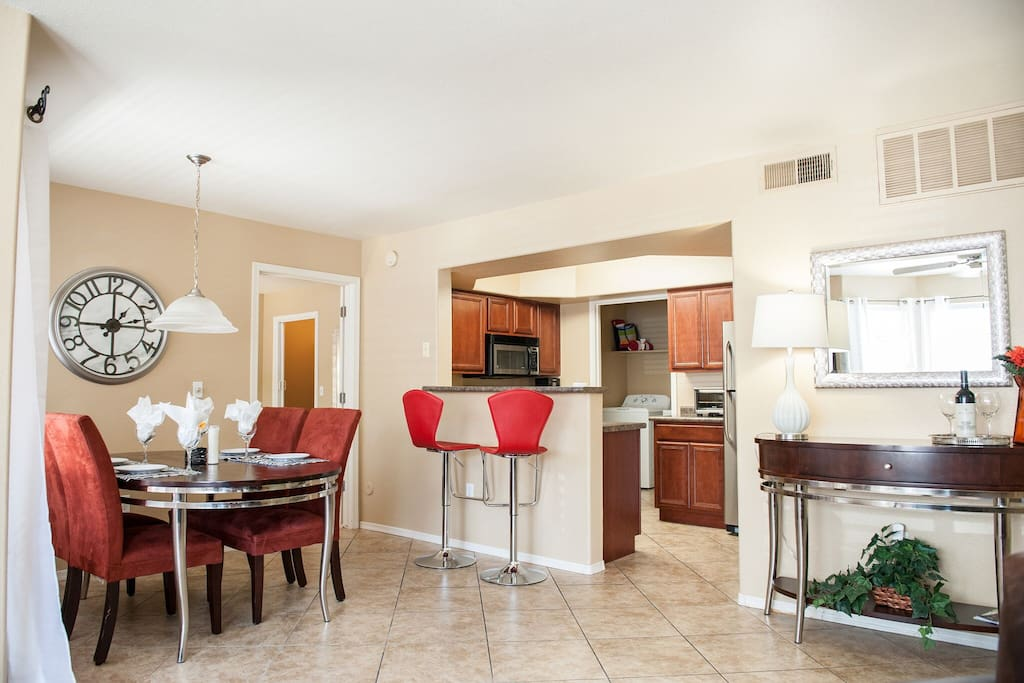 Dining, breakfast bar, and kitchen