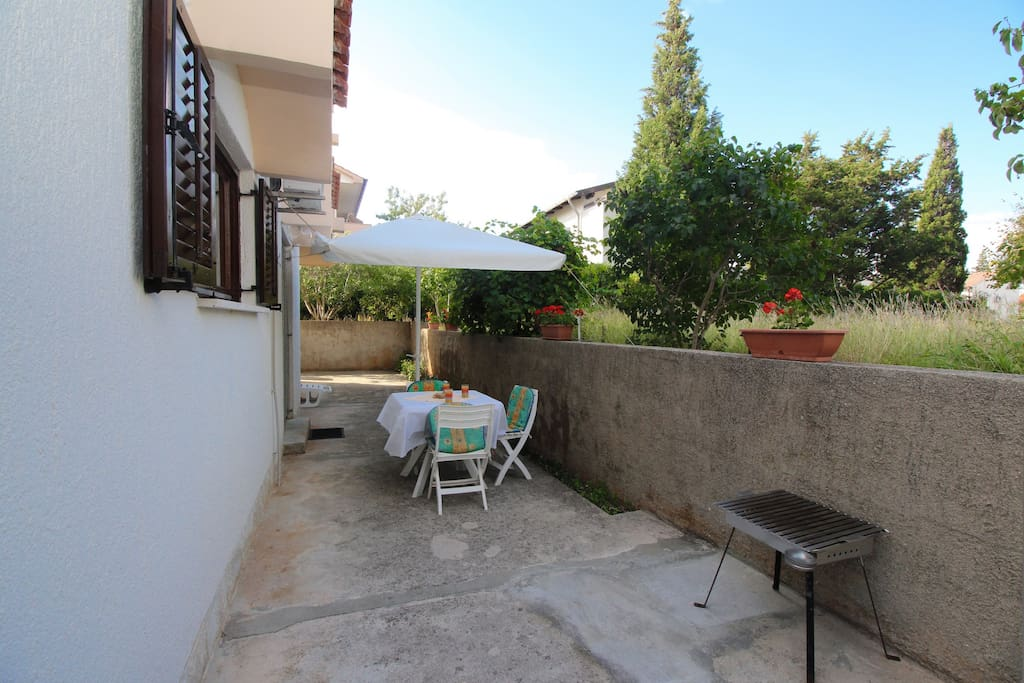 Terrace with sitting space and portable barbecue