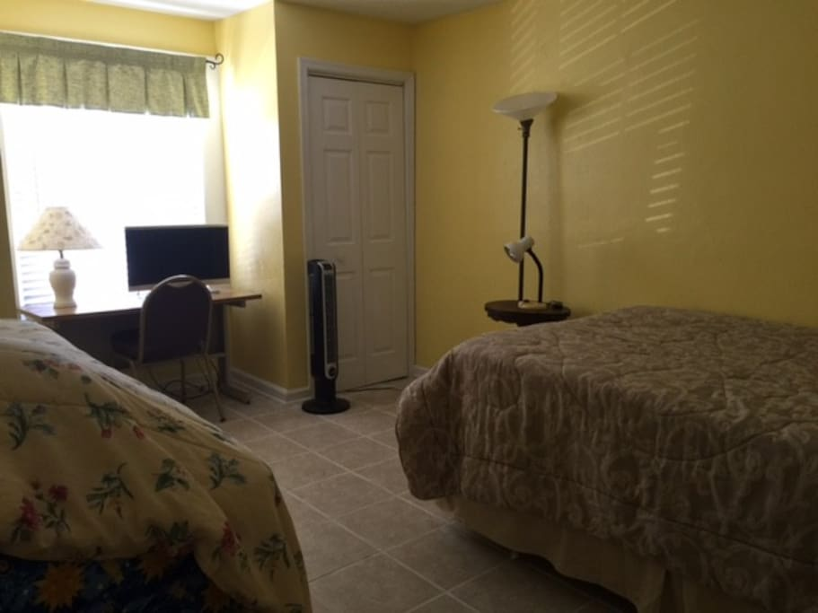 Spacious 2nd bedroom with 2 twin trundle beds + full size bed