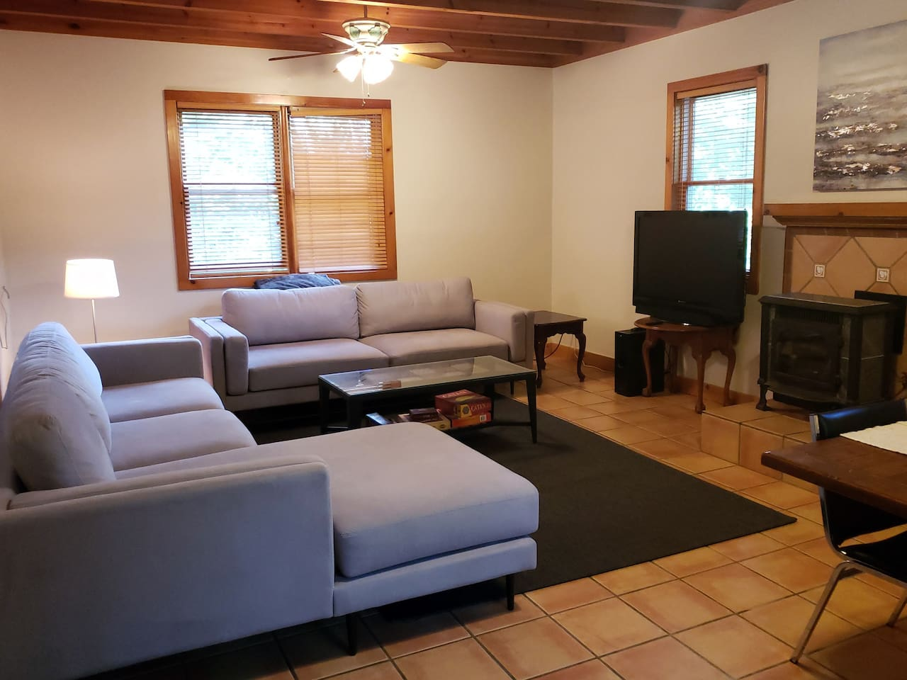 Shared Great Room with streaming services, games, and large dining table.