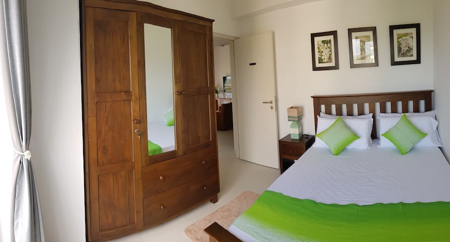Colours to complement the nature, Comfortable double bed, Air conditioning, Ceiling fan, private balcony to watch the sun sink into the Indian ocean.