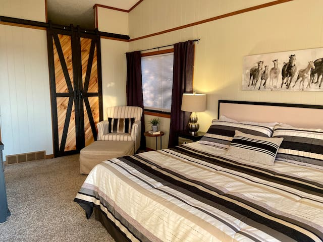 Bedroom # 2 with access to shared bathroom, extra large closet, full access to upper deck.
