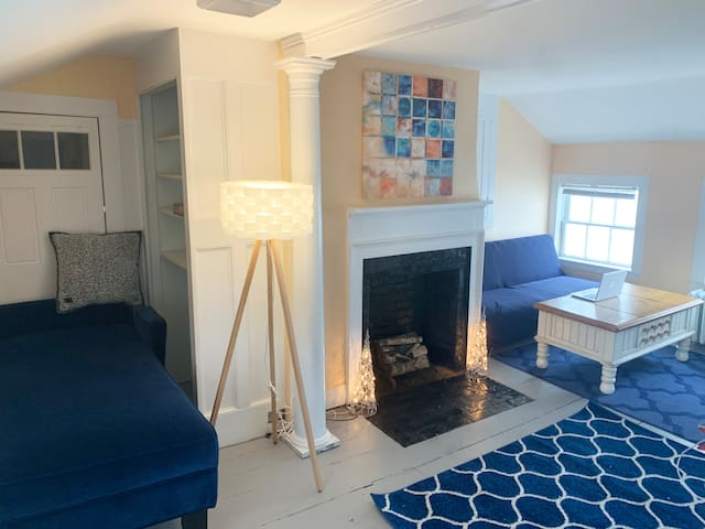 Living room with extra spot for friends and family to stay. Futon couch and sleeper chair.