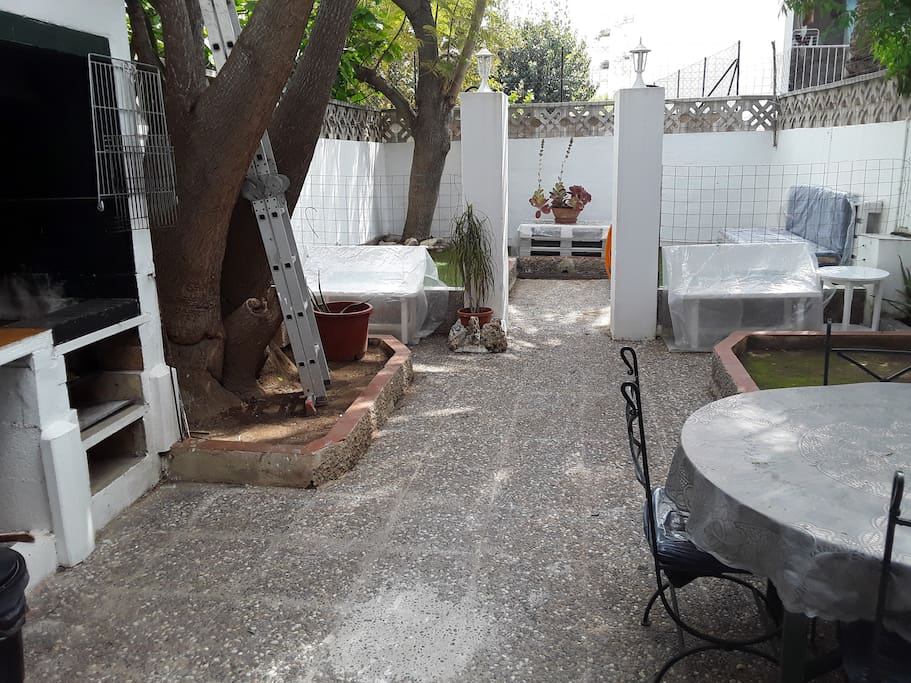 Spacious patio with lounge area, built-in BBQ and outdoor dining area