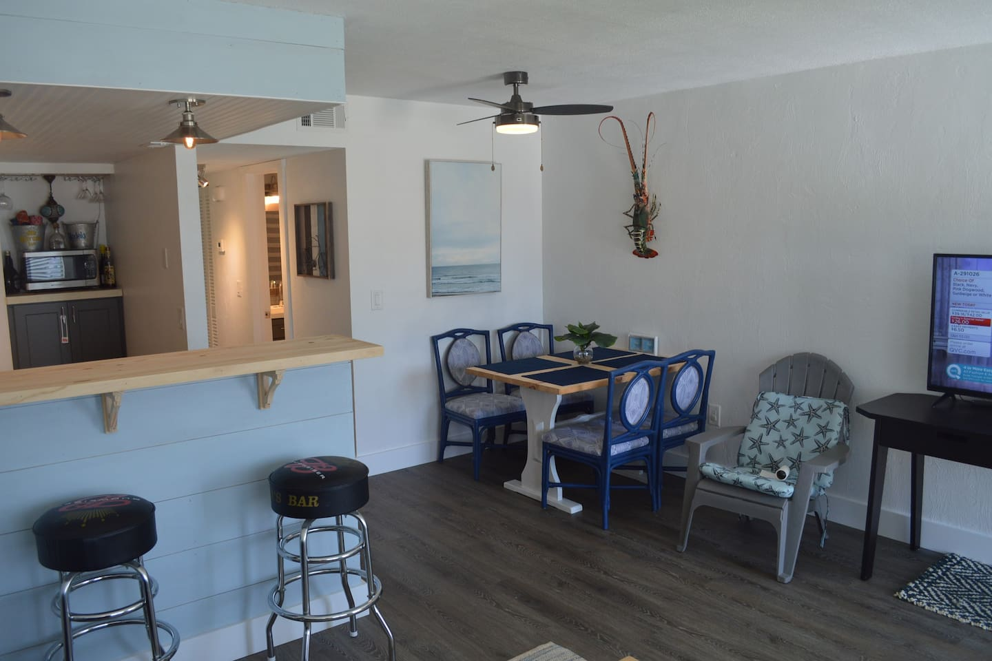 Open concept living, dining and kitchen.  Great lighting from the front window and storm door.