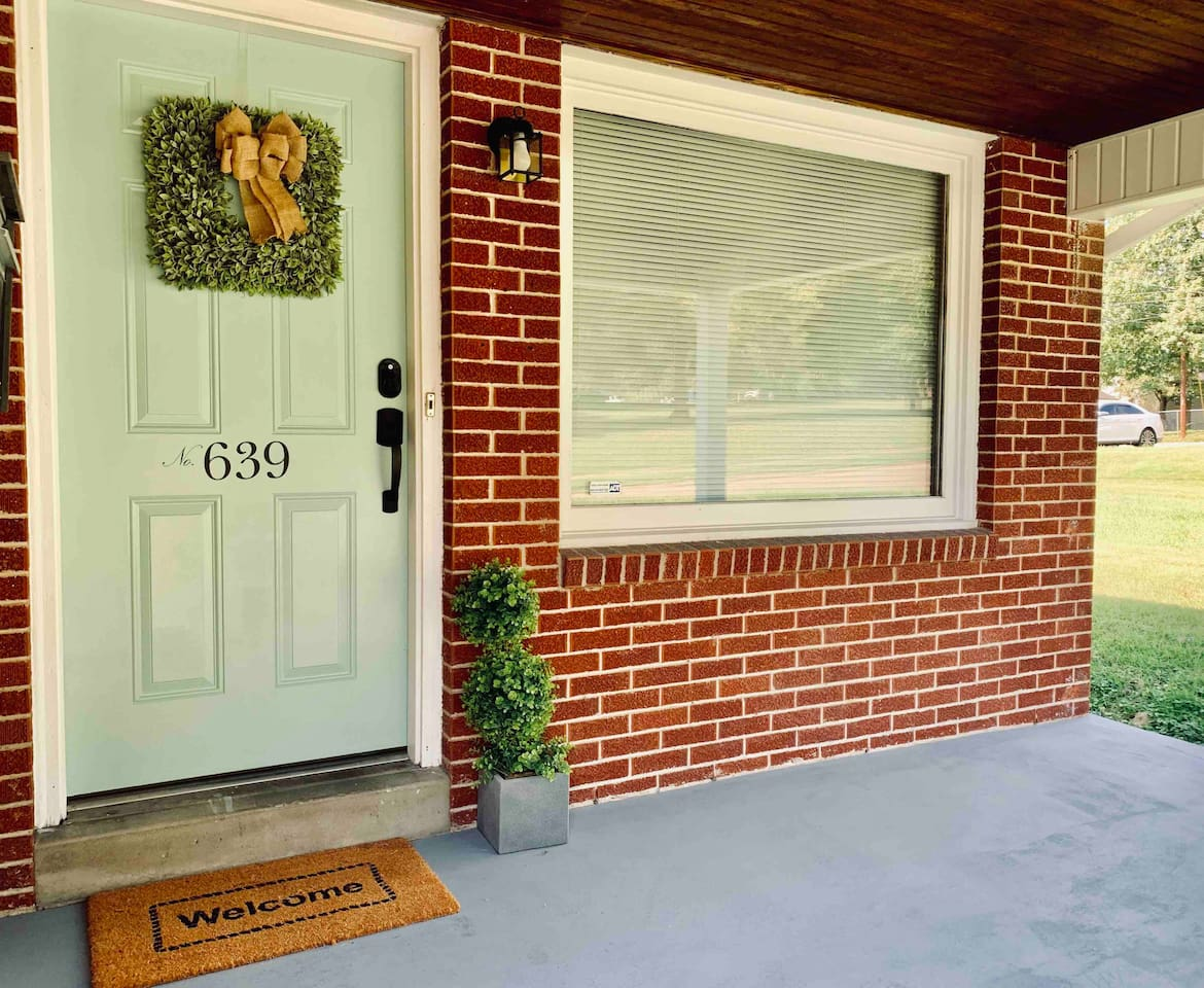 Welcoming front entry with covered front porch and keyless door lock.
