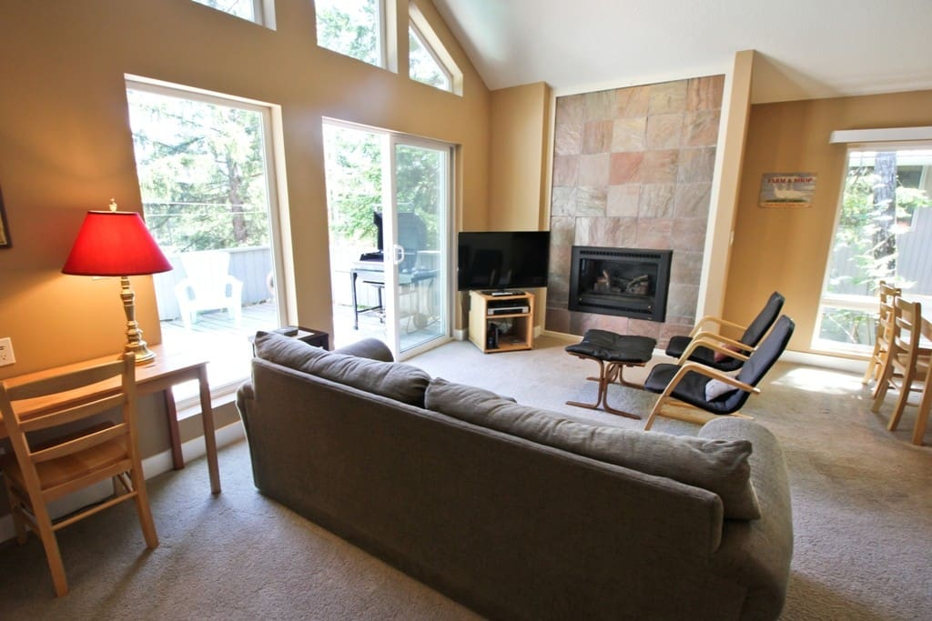 Upper level living room with a flat screen cable TV/Bose DVD player, surround sound, gas fireplace and a slider leading out to the deck