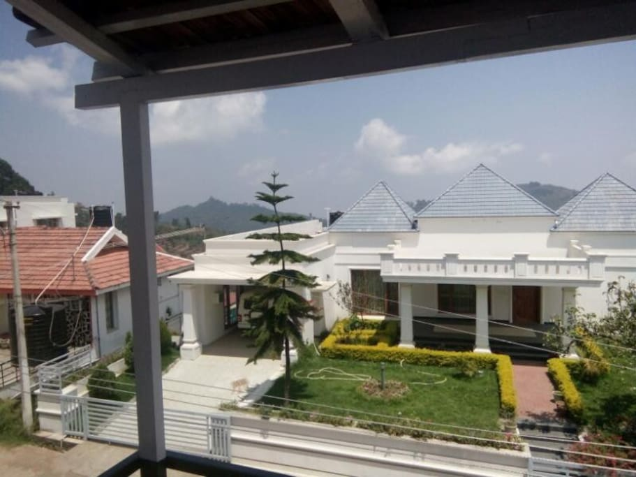 balcony with bungalow, city & long river view