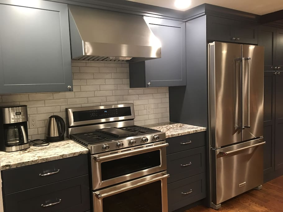 Brand new kitchen - KitchenAid appliances, custom cabinetry and gorgeous marble. Completed Thanksgiving 2017!