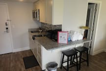 New kitchen with granite counter tops, coffee & coffee maker, guest towels & toaster oven.