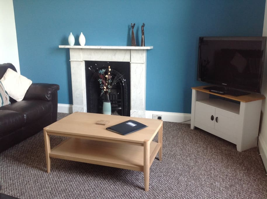 Lounge with superb views over to Grizedale out of the main window. The room contains a sofa, TV & cabinet, DVD player, electric wall heater and feature fireplace.