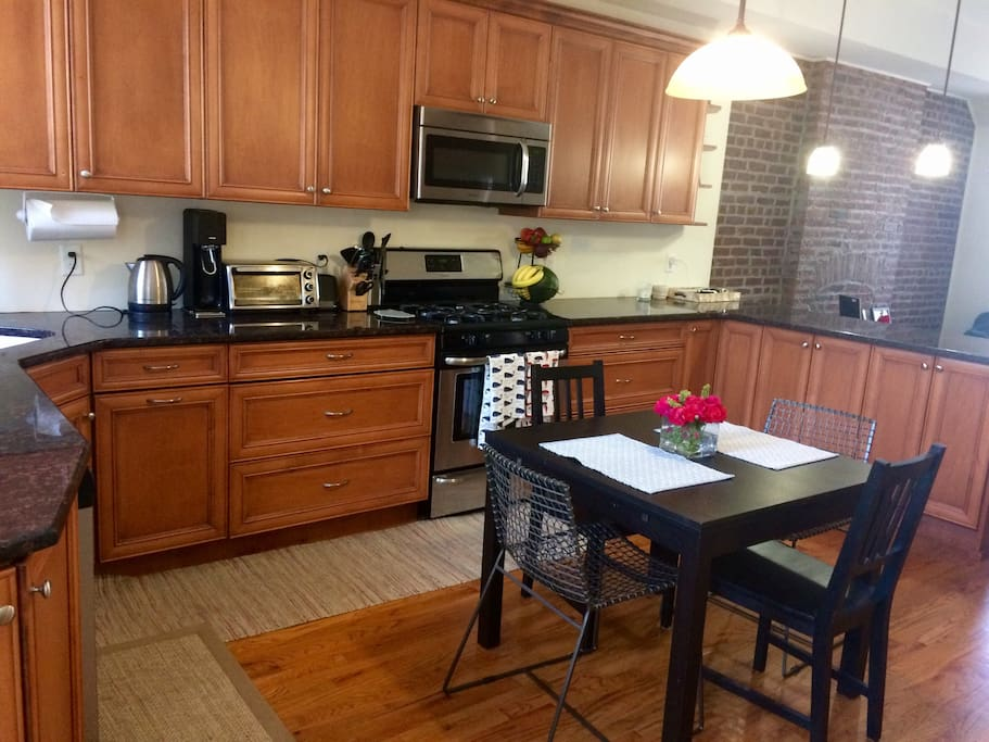 Large kitchen perfect for cooking! Table seats 4 with 4 additional bar stools at breakfast bar.