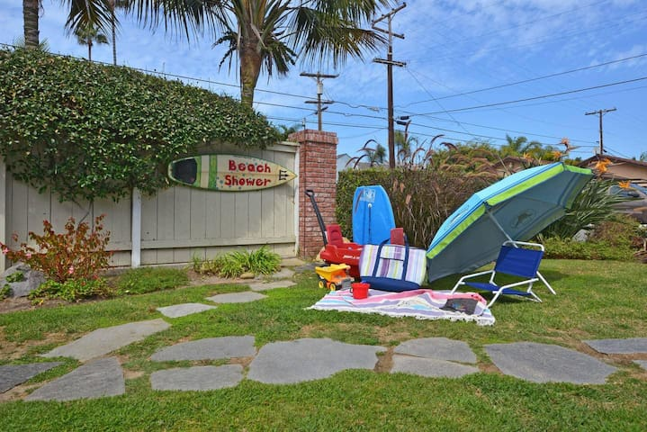 Outdoor shower, 2 wagons, umbrellas, plenty of chairs, coolers, beach mats, boogie boards and toys