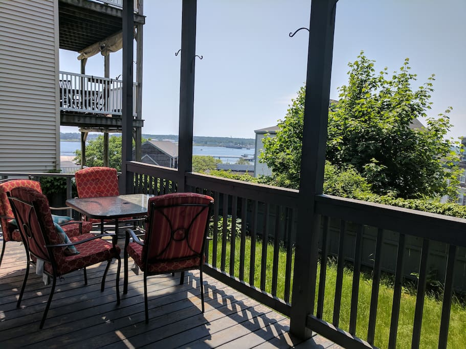 Huge private deck has water views and leads to the grassy backyard.  Perfect for lawn games or move the chairs out into the sun!