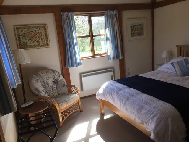 Large bedroom overlooking paddock