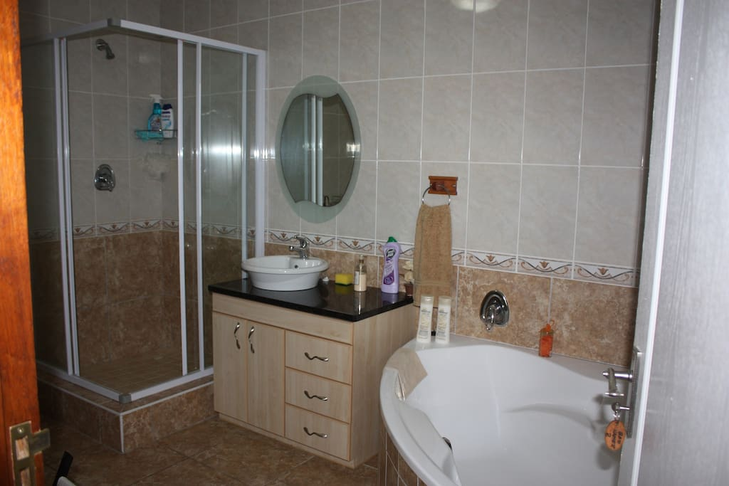 Stand alone bathroom with bath, shower, basin and wc.