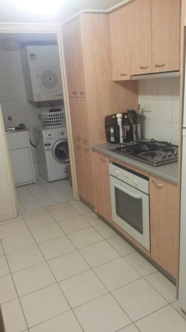 Kitchen with walk through to laundry- fully equipped with gas cooking, fridge/freezer & dishwasher