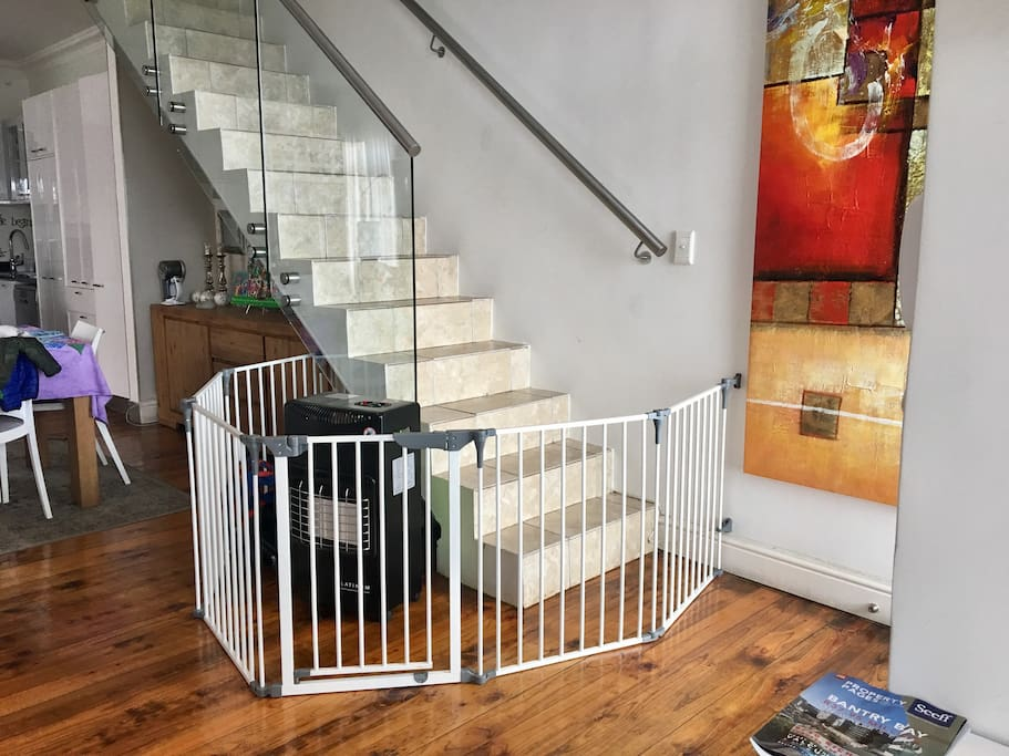 Baby safety gate at the bottom and top of the stairs