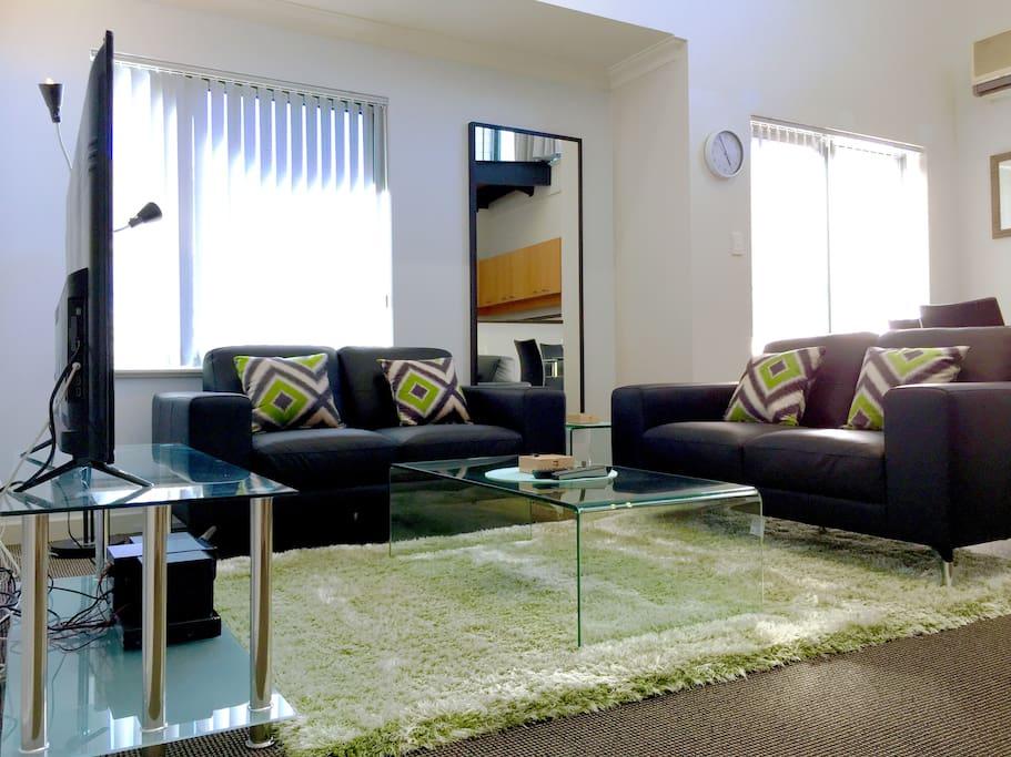 Lounge with large LED TV.