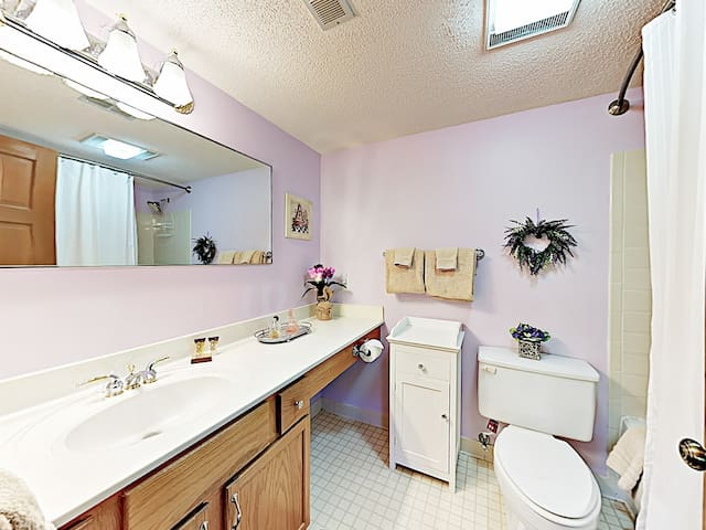 The en-suite master bathroom offers plenty of space to refresh.