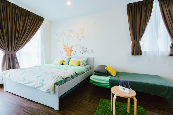 masterbedroom with sofa bed and king size bed