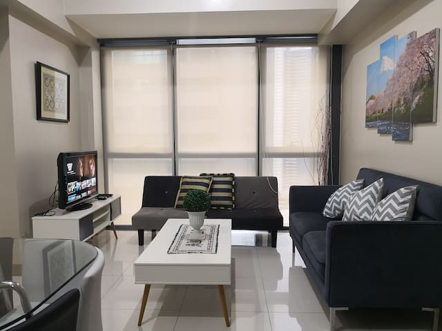 New 1BR at Eastwood w/ Fibr + Netflix and iFlix