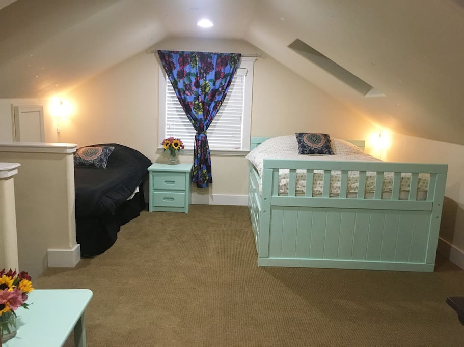 First room at the top of the stairs with one double bed, and one twin extra long bed.
