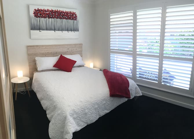 Luxurious Queen Bedroom with TV and ceiling fan