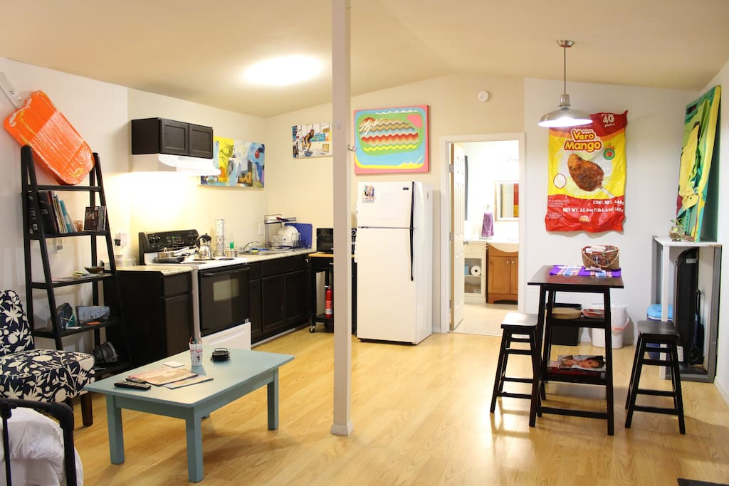 Space has kitchenette, refrigerator, and dining area