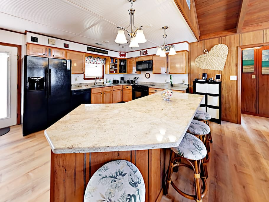 Whip up a gourmet breakfast in the newly remodeled kitchen with views of Mobile Bay.