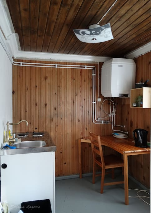 Mini kitchen with fridge, 2 electric cooker, waterboiler, coffee maker.