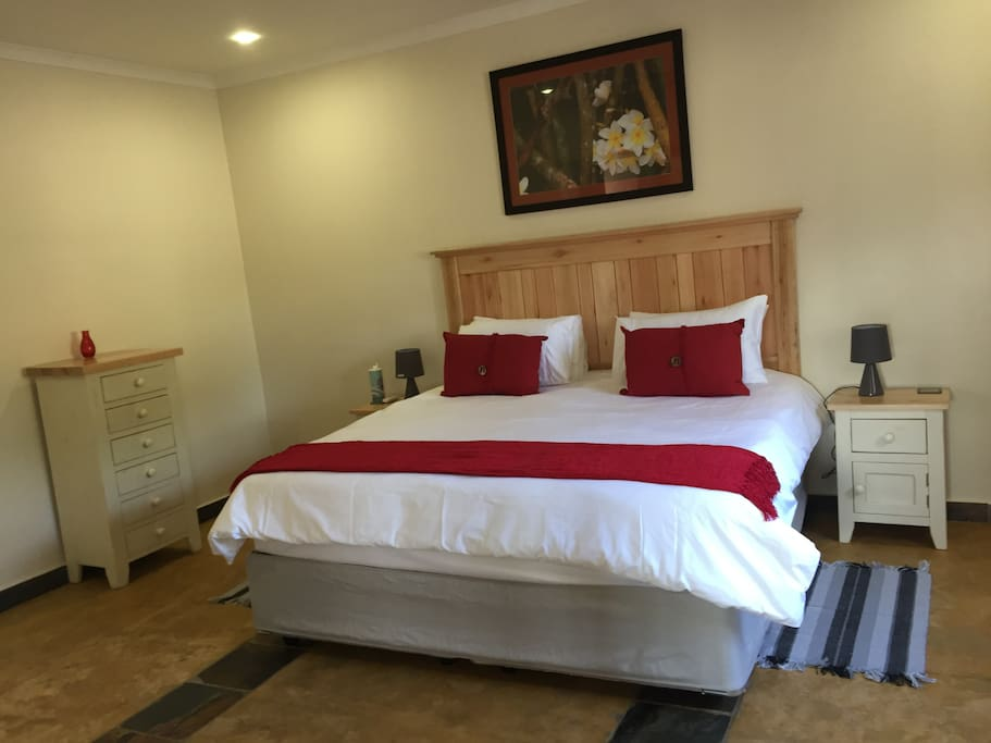 Ensuite bedroom with Kingsize bed and luxury bed linen