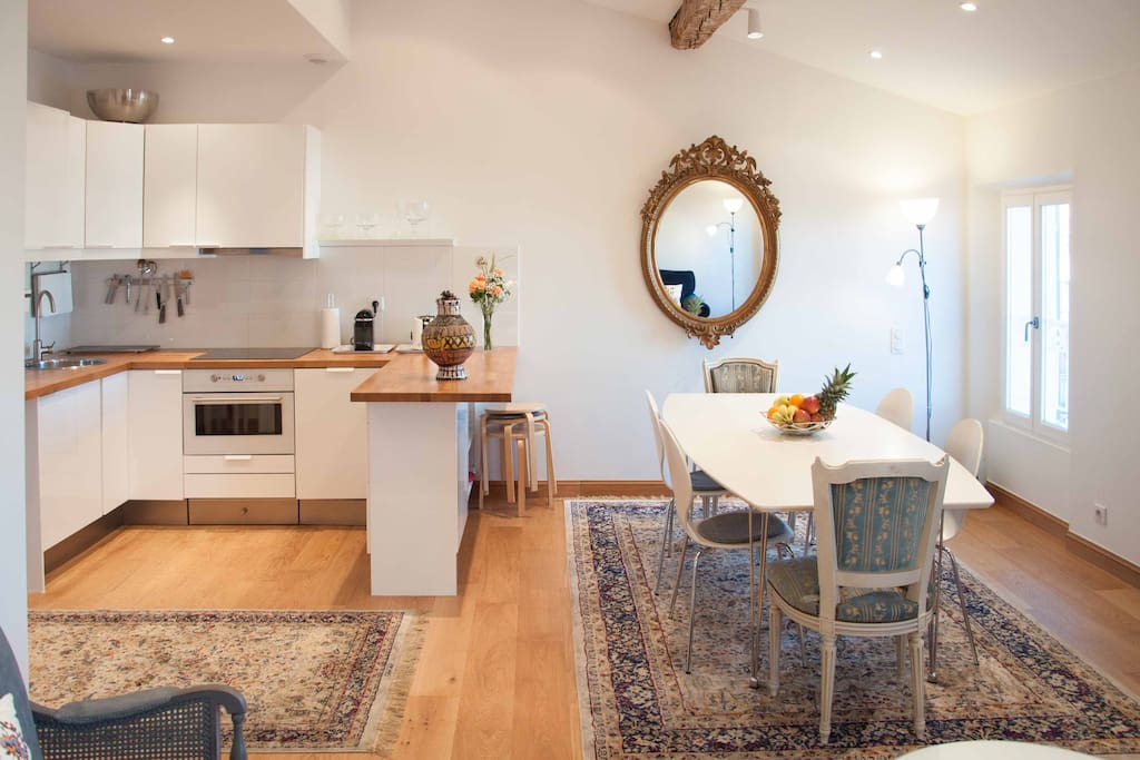 Open kitchen with dining for 12 people, table can be extended.