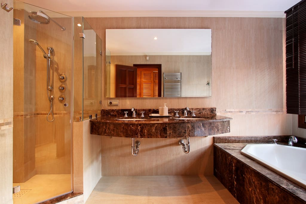 Luxurious en-suites feature polished marble, Italian stone, double-ended bath tubs, rain showers and fine toiletries.