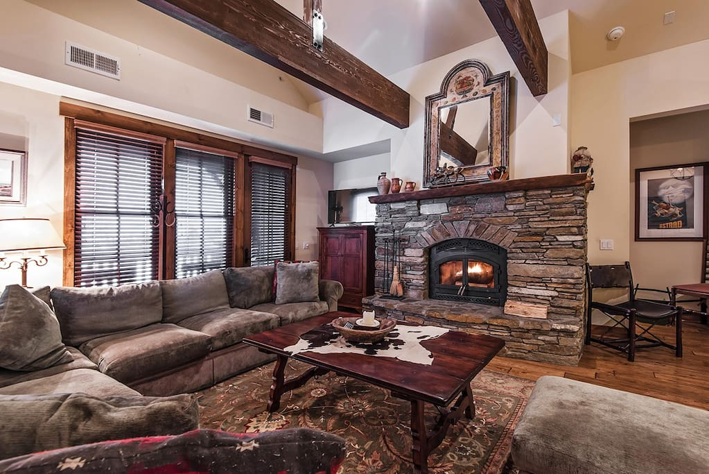 Living room with stacked stone fireplace and mountain decor