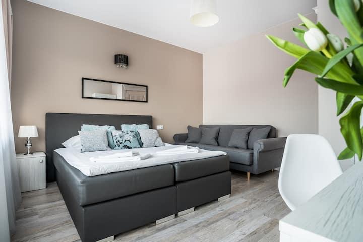 Comfort Quadruple Room with Balcony - Roomworld