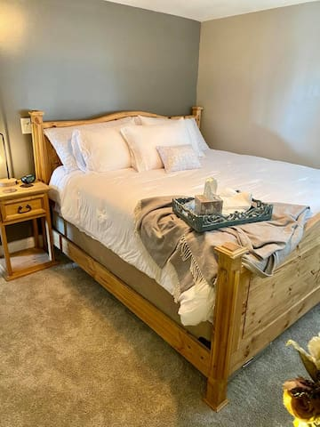 King room-amenities include-extra pillows, throw blanket, alarm clock, lamp with USB ports extra bedding