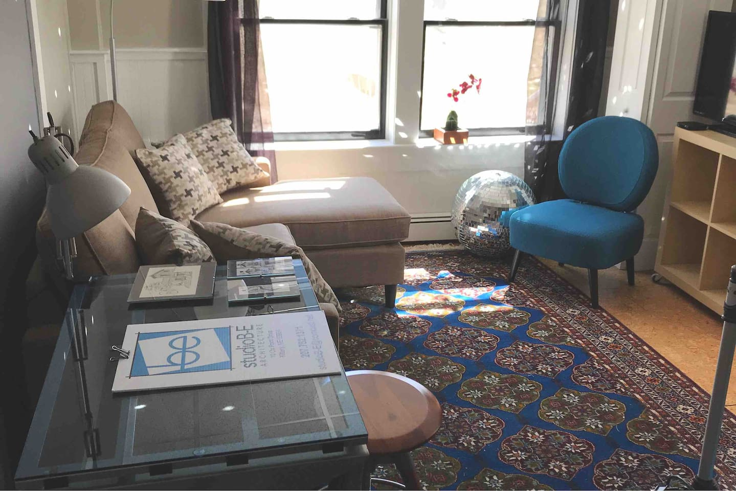 Separate living room with queen size pull out sofa