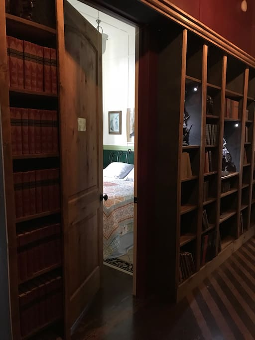Through the bookcase door you will find the Clark Room awaiting you!