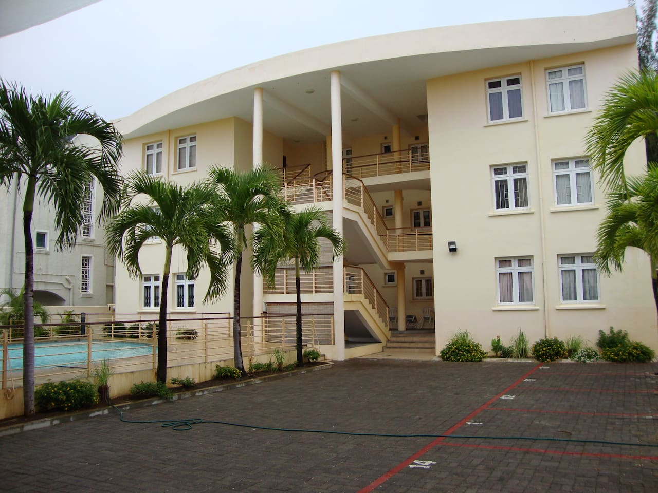 Rear view of the building where the apartment is on the first floor