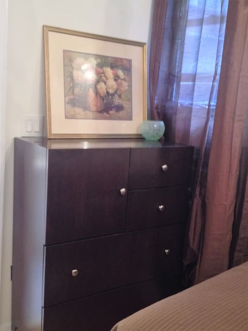"The Dresser has at least 2 drawers available for you plus in the square ""Cabinet"" an iron, small fan, extra sheets & blanket and 2 umbrellas"