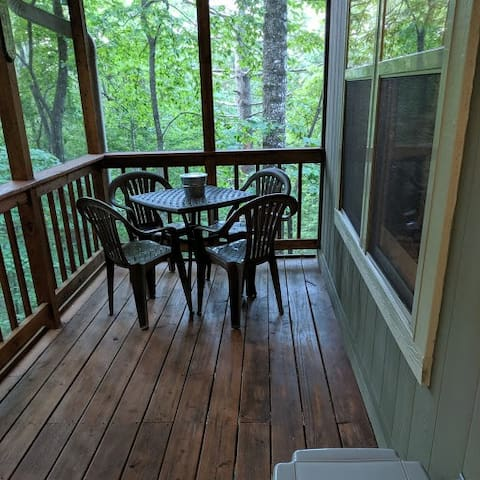 Enjoy eating on the upper level screened in porch while listening to the sounds of the creek below.