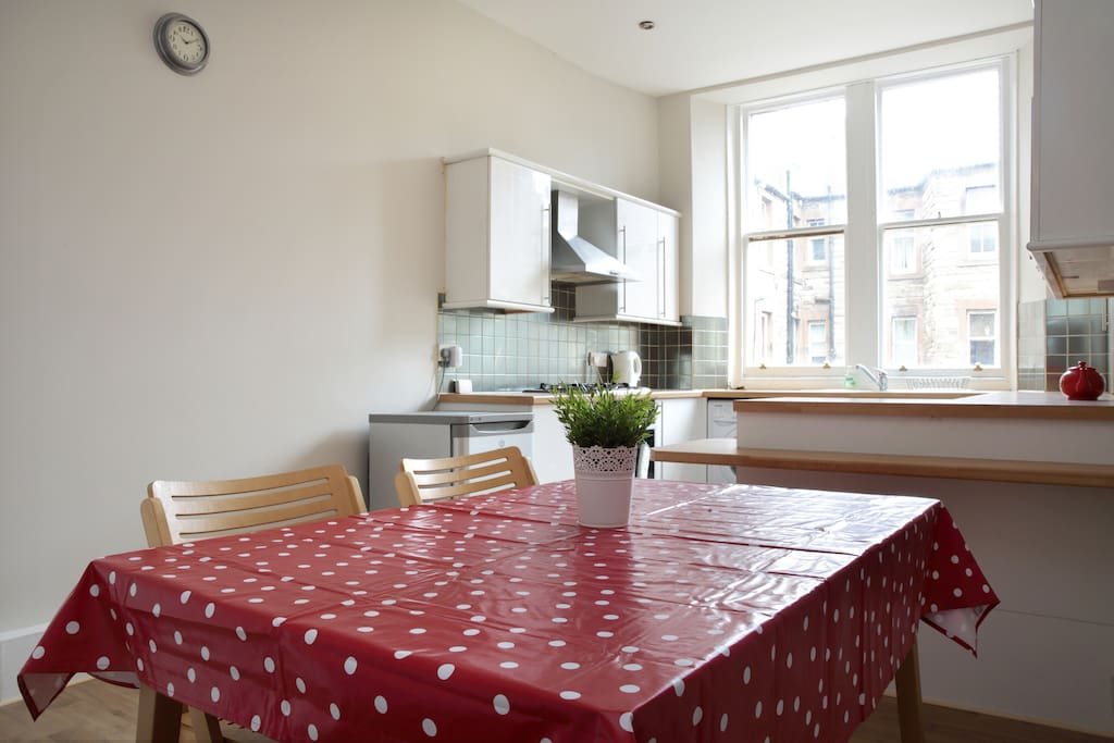 Large dining table in the light and airy kitchen