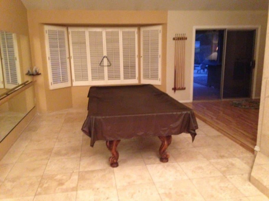 Pool table for some competitive fun.